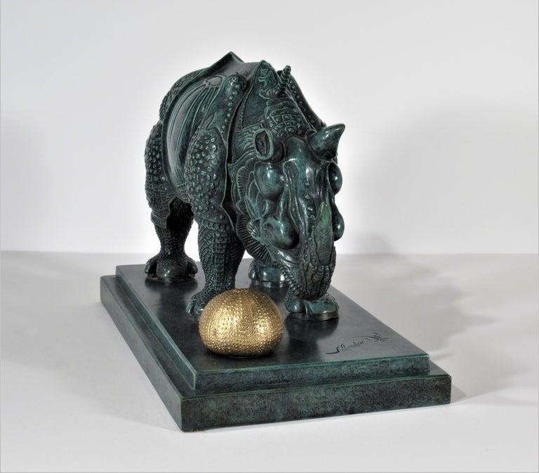 Rhinoceros Habille en Dentelles - Gold Figurative Sculpture by Salvador Dalí
