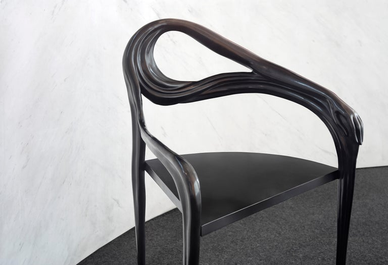 Leda armchair designed by Dali manufactured by BD.  All pieces of ironwork in this collection are made of brass. The Black Label Leda collection has an artisanal application of a special patina (metal dissolved in nitric acid) which is applied to