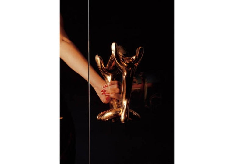 Knob Rinocerontico designed by Salvador Dali produced by BD design.  Three polished lacquered cast bronze pieces joined together.  Measures: 13 x 38 and door x 24 H cm   During the 1930s in Paris, Salvador Dalí surrounded himself with a circle