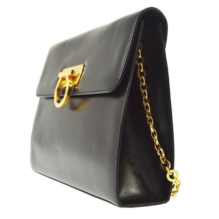 15636af9640 Salvatore Ferragamo Black Leather Gold 2 in 1 Clutch Shoulder Chain Flap Bag  In Good Condition