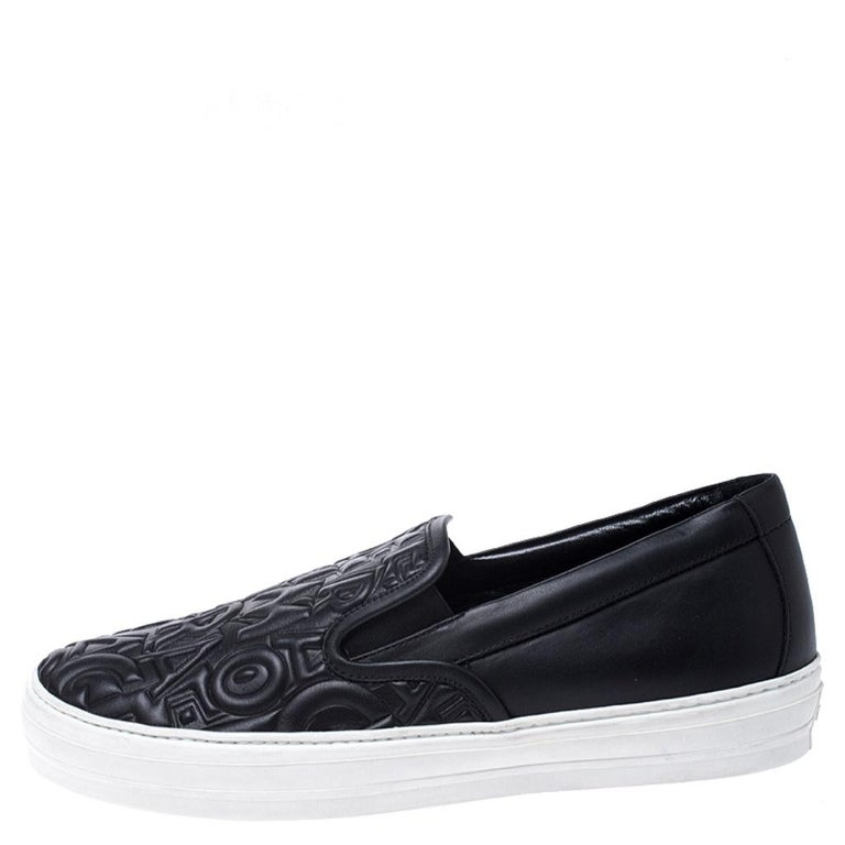 A pair of black sneakers is a must-have any season. Made from black logo-embossed leather, these sneakers come with thick white rubber soles to provide comfort and grip. The sneakers are easy to slip on and off. Pull off the street-chic look with