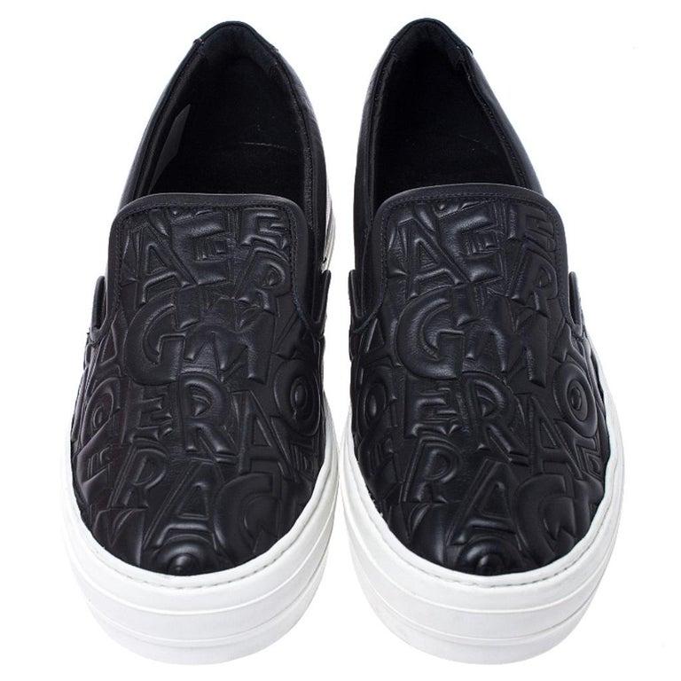 Salvatore Ferragamo Black Logo Embossed Leather Slip On Sneakers Size 40.5 In New Condition For Sale In Dubai, Al Qouz 2