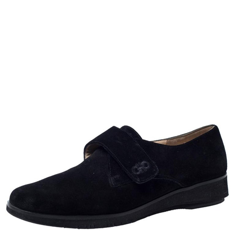 Celebrating the fusion of fine craftsmanship and luxury fashion, these Salvatore Ferragamo shoes are worthy to be worn by you. They bring single velcro straps on the vamps and are so well-crafted with black suede to look fashion-forward. The leather