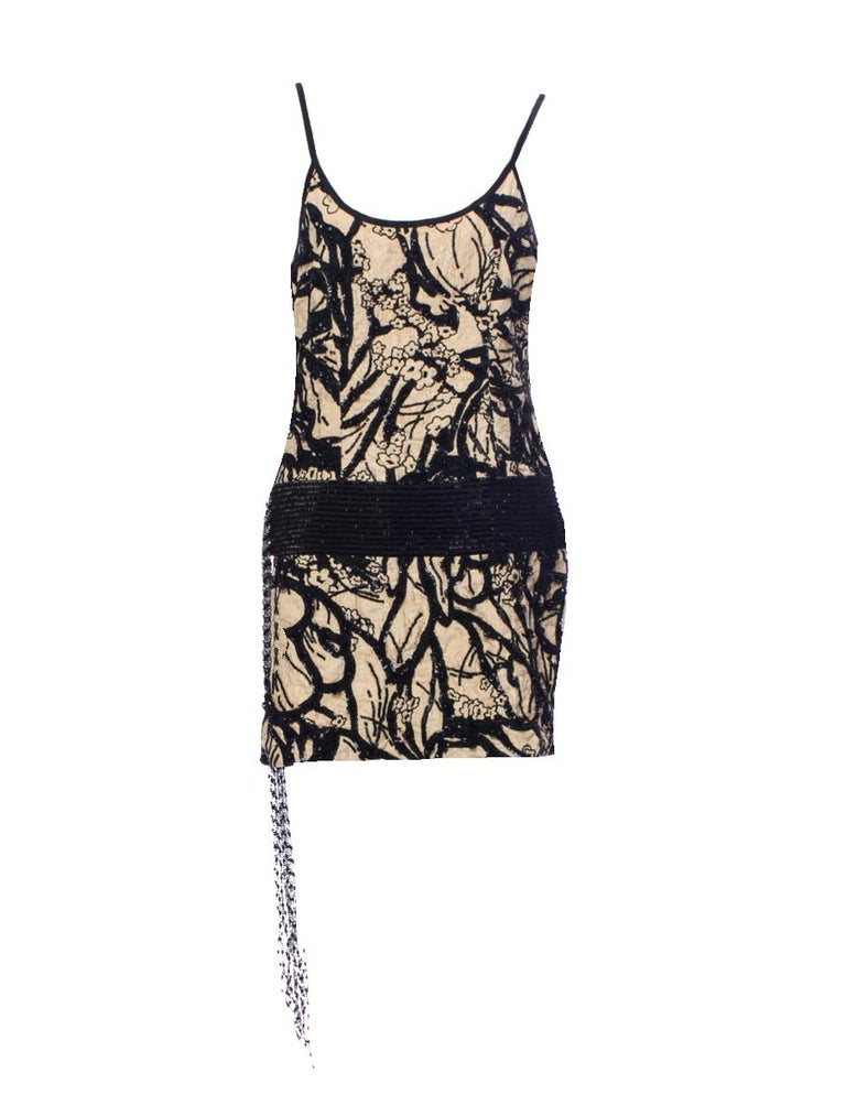 Stunning cocktail dress / tunic by Salvatore Ferragamo Exceptional piece - heavily embroidered Can be worn either as dress or tunic with pants Made in Italy Dry Clean Only  Size 42 RRP 5490$ plus taxes