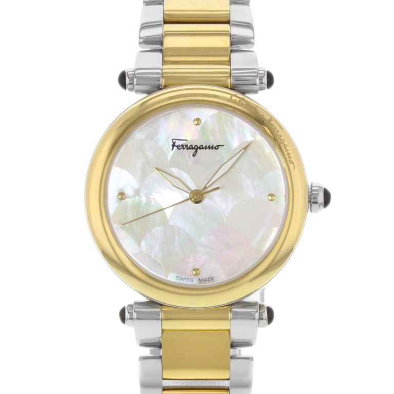 (19656) This display model Salvatore Ferragamo Idillio FCH060016 is a beautiful Ladies timepiece that is powered by a quartz movement which is cased in a stainless steel case. It has a round shape face, no features dial and has hand dots style