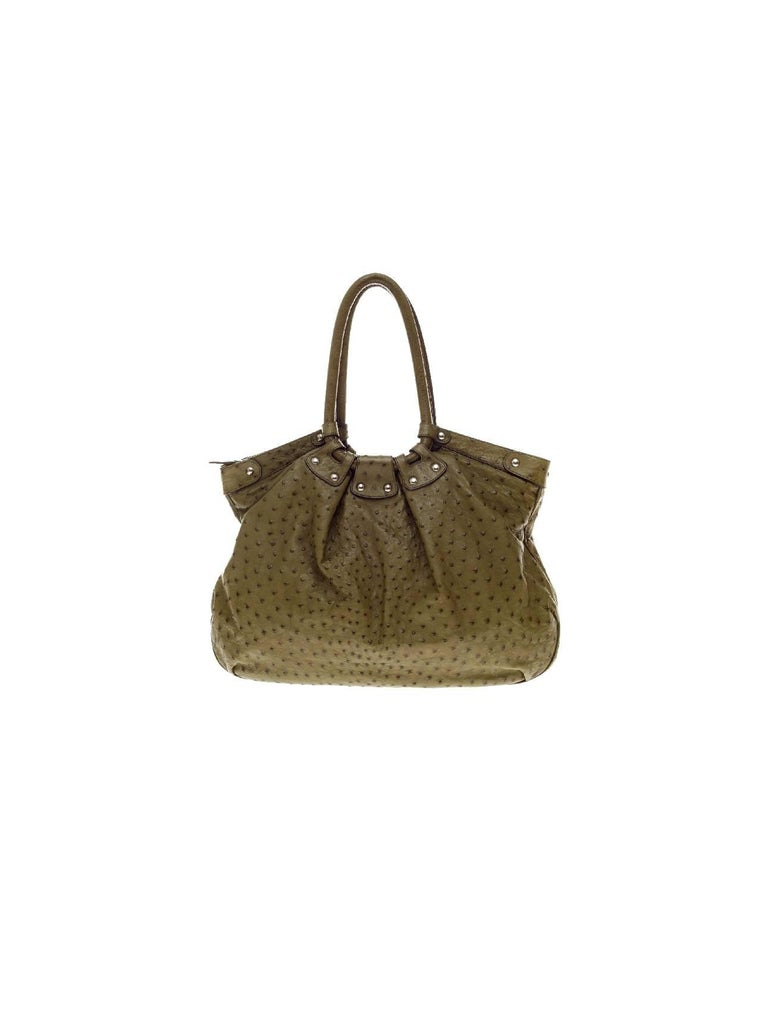 Stunning Real Ostrich Skin Shoulder Bag by Salvatore Ferragamo - a timeless classic!  Made of finest ostrich skin Olive green color Fully lined with chocolate brown suede leather One inner bag with zip closure, three open inner bags for phone