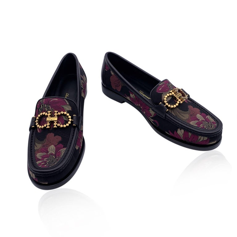 Beautiful Salvatore Ferragamo 'Rolo T' Moccassins Loafers Shoes. Crafted in leather with floral fabric upper. They feature a round toe, gold metal Gancini detailing on the toes and slip-on design. Leather sole. Padded insole. Heels height: 1cm. Made