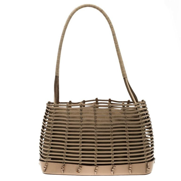 0f409f68ff You can look different and chic by carrying this uniquely designed caged  leather tote with spiraled
