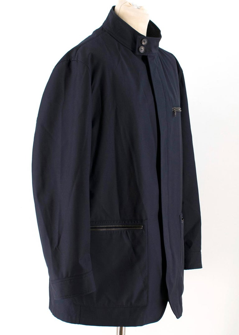 Salvatore Ferragamo Navy Padded Trench Coat    - Navy medium length coat made in technical fabric - The coat has removable padded vest with zip fastening - Zip closure - Two button fastening of collar stand - Cotton Collar insert inside - Two large