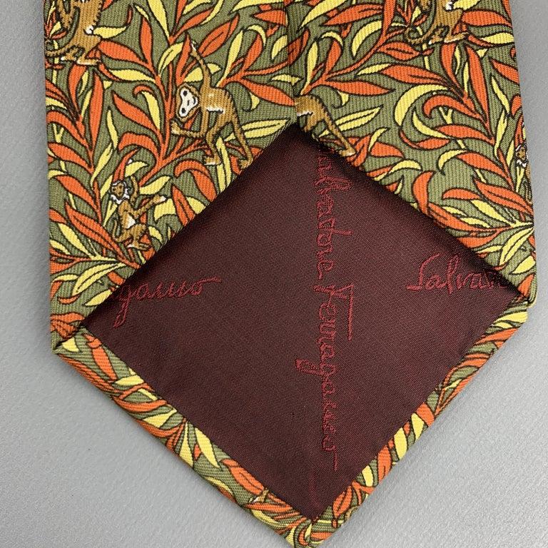 SALVATORE FERRAGAMO Olive Green & Orange Silk Monkey Print Tie For Sale 1
