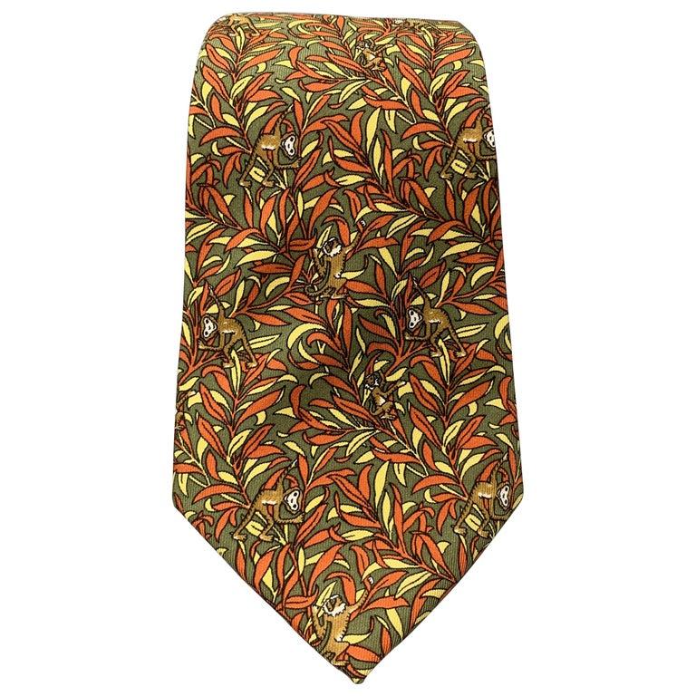 SALVATORE FERRAGAMO Olive Green & Orange Silk Monkey Print Tie For Sale