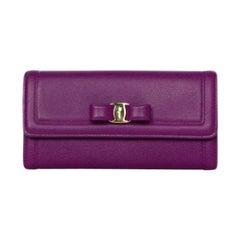 Salvatore Ferragamo Purple Textured Leather Vera Bow Wallet rt. $490