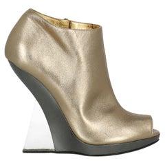 Salvatore Ferragamo Woman Ankle boots Gold Leather IT 39