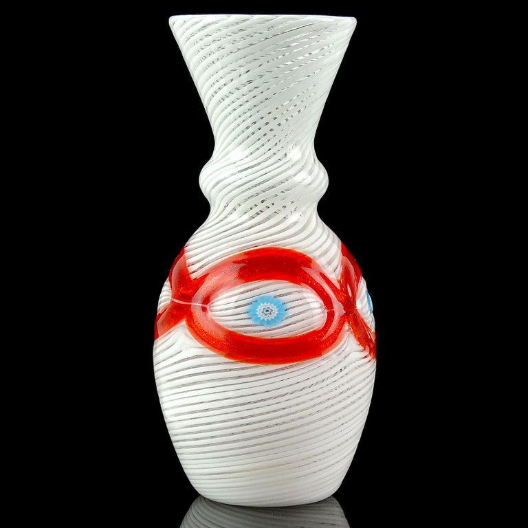 Beautiful Murano hand blown white Filigrana ribbons, red-orange aventurine and blue millefiori canes Italian art glass cabinet vase. Documented to Salviati & Co., with intact original label still attached. It reads