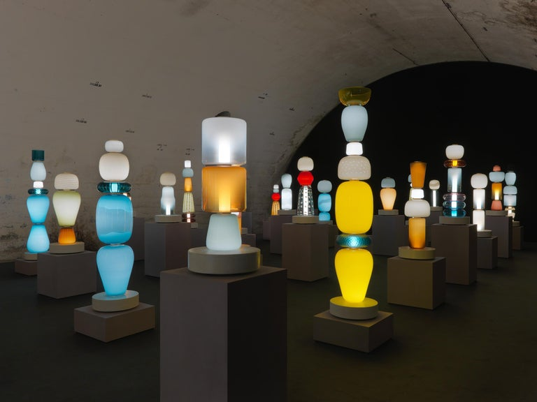 Pyrae is a Latin word that illustrates the concept of modularity. There are 53 luminous objects related to the human figure and obtained by assembling 102 modules from different shapes, colors and workings, creating over 10,000 original