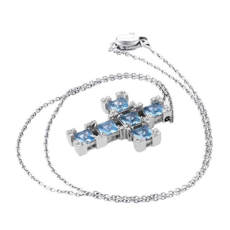 An exquisite combination of elegant 18K white gold, classy diamonds and delightful aquamarine, this gorgeous Salvini necklace boasts luxurious classy appearance; the necklace boasts a drop of 9.25 inches and an eye-catching cross pendant set with