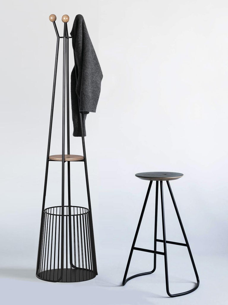 Sama coat rack is part of the Sama collection, which provides functionality through simple, yet striking and sculptural forms that add a unique and elegant touch to its environment.  Inspired by the poetry of whirling costumes worn in Sama
