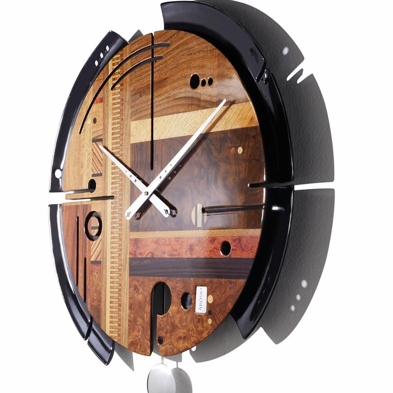 Featuring Canaletto walnut, rosewood, zebrawood, and Bubinga woods alongside walnut and elm briarwood inlays with a glossy finish give the stunning face of this superb wall clock a striking allure, ideal to add a one-of-a-kind accent to a