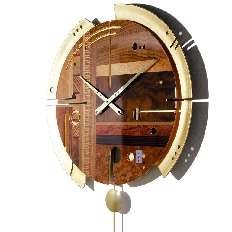 Part of a special edition, this wall clock is an exquisite addition to a modern interior. Its structure in wood pulp with a silent quartz mechanism made in Germany is adorned with a face boasting elm and walnut briarwood with rosewood, Bubinga,