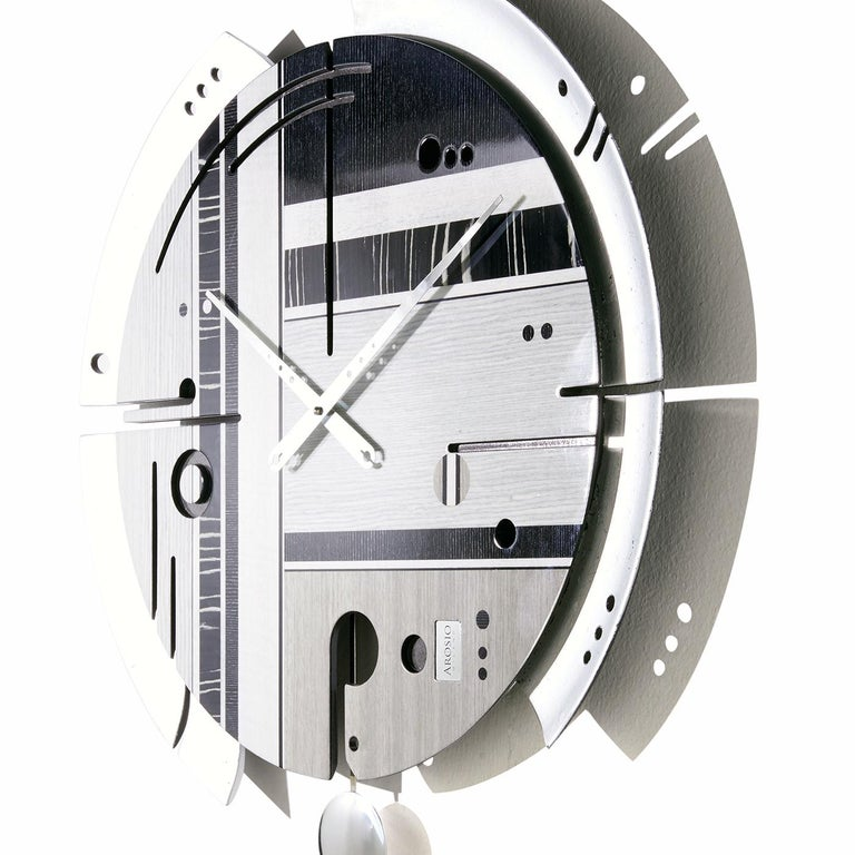 This stunning wall clock is part of a special edition series featuring a precious frame finished with silver leaf. A work of functional art, this piece has a wood pulp structure enclosing a silent mechanism made in Germany and operating with an AA