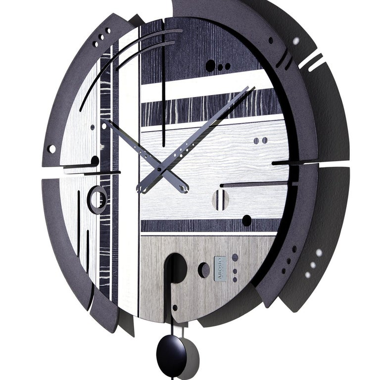 Striking and unique, this wall clock is a superb addition to a modern or industrial interior. The wood pulp structure encloses a silent quartz mechanism that is made in Germany and operates with an AA battery (not included). The face of the clock