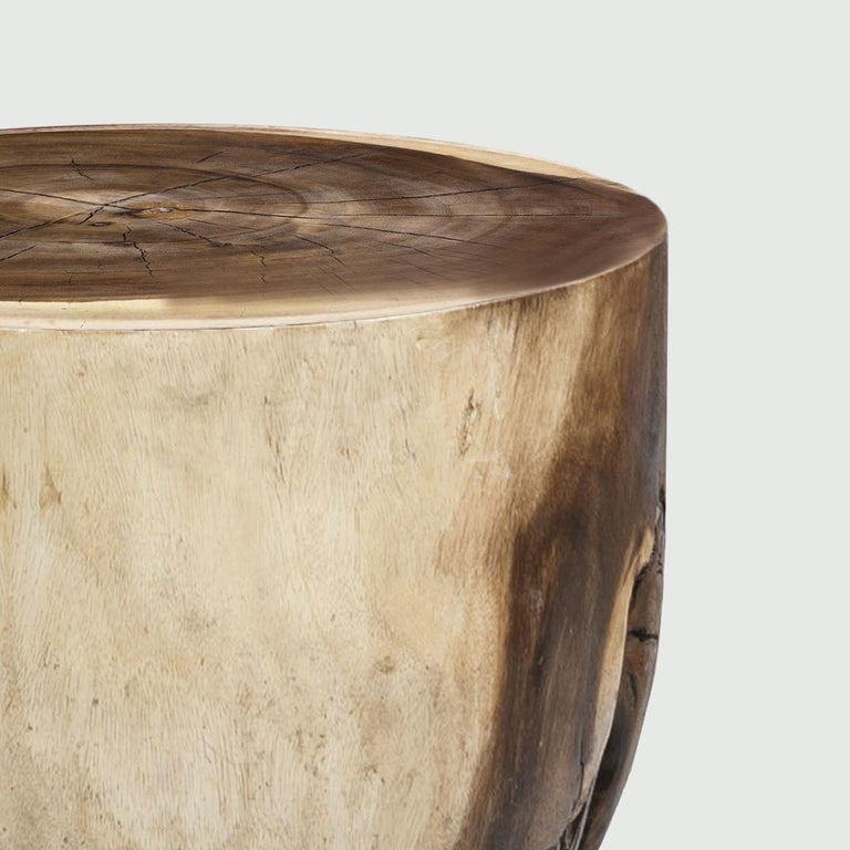 A spontaneous, unrefined flair marks this exclusive coffee table, minutely handcrafted from a single trunk of prized acacia. Also suitable as a low stool, the design showcases a bold silhouette softly decreasing its diameter while approaching the