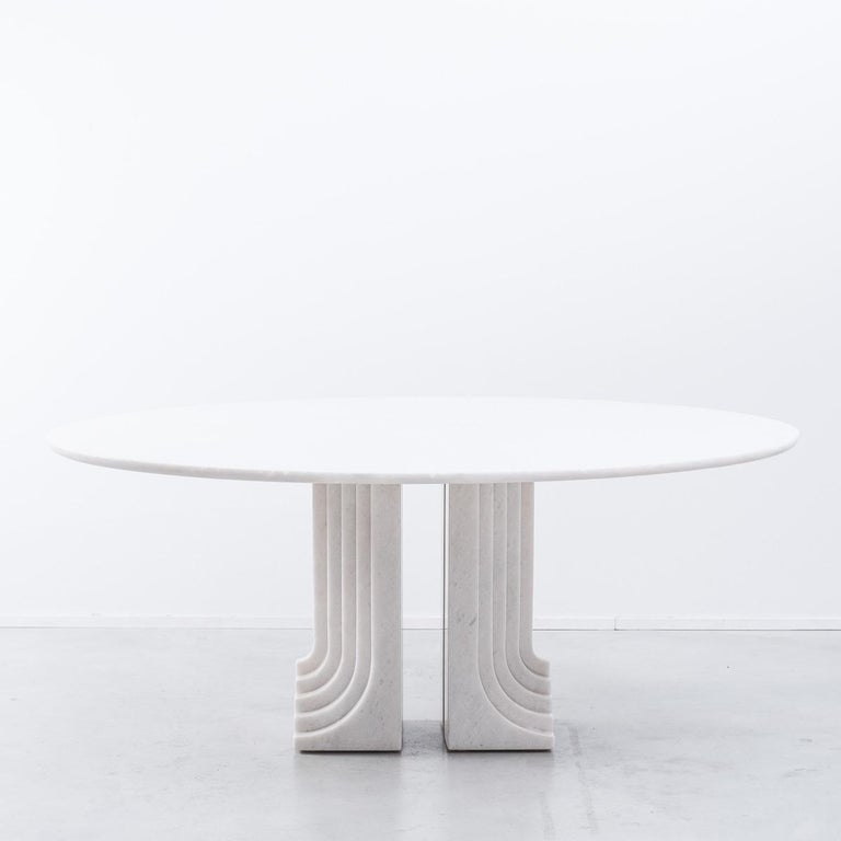 Carlo Scarpa 'Samo' table, produced by Simon, Italy, 1970s. Part of the 'Ultrarazionale' collection by Simon, the base is formed of two pillars of Carrara marble, layered like map contours in relief. The oval tabletop floats of this marble monolith.