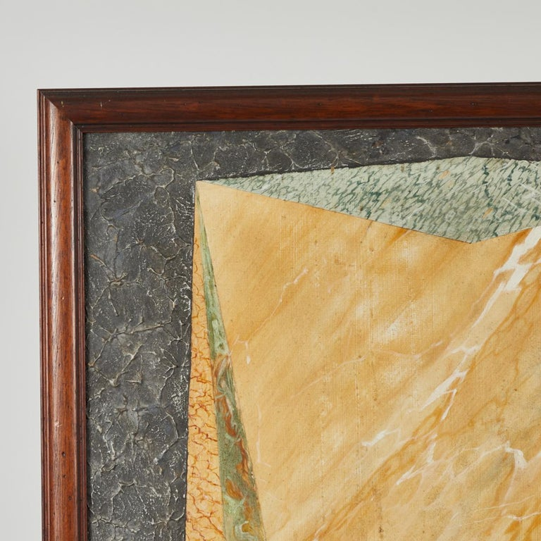 A painter's sample board in wood frame.