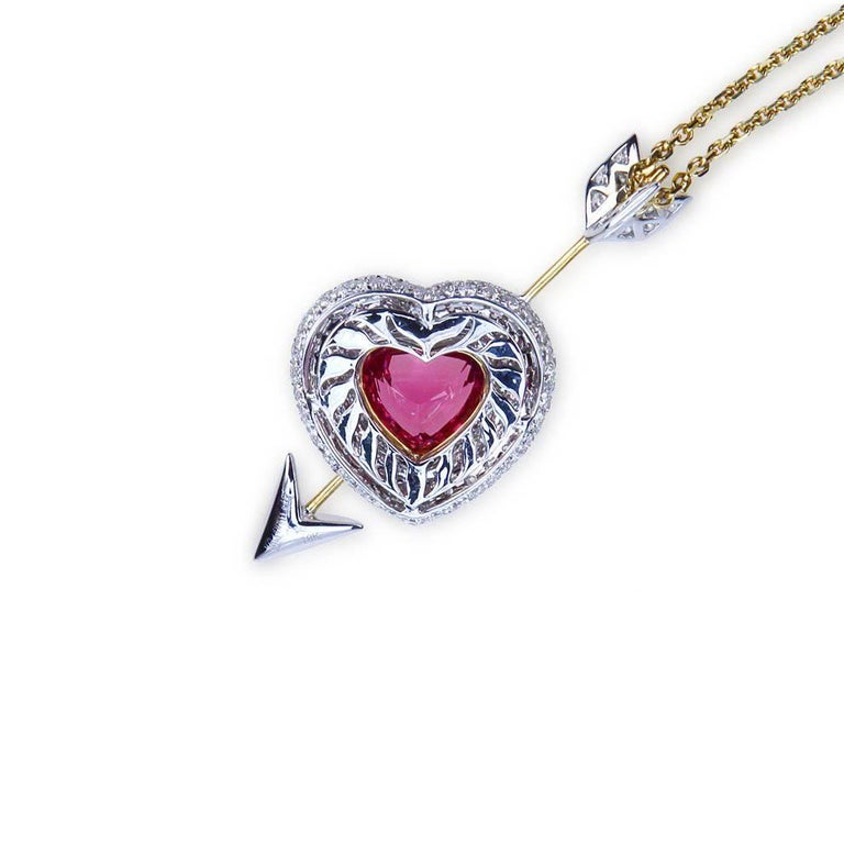 """A """"Samuel Getz"""" 18 Karat Yellow and White Gold """"Heart & Arrow"""" Pendant Featuring A Heart Shape Hot Pink Spinel, 4.20 Carat [9.28 x 10.85 x 6.47 mm] [Burma] and 162 Round Brilliant Diamonds, 3.91 Carats of F Color and VVS1 – VS1 Clarity. The"""