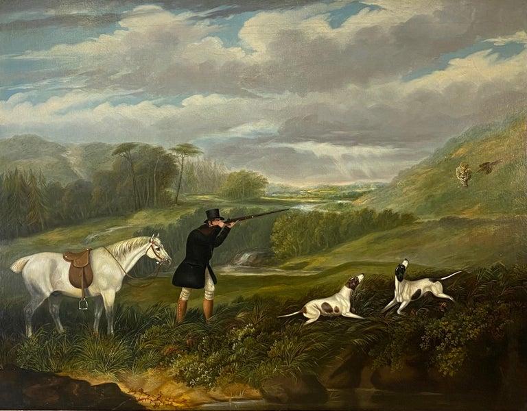 A gentleman partridge shooting in a landscape with dogs - Painting by Samuel John Egbert Jones