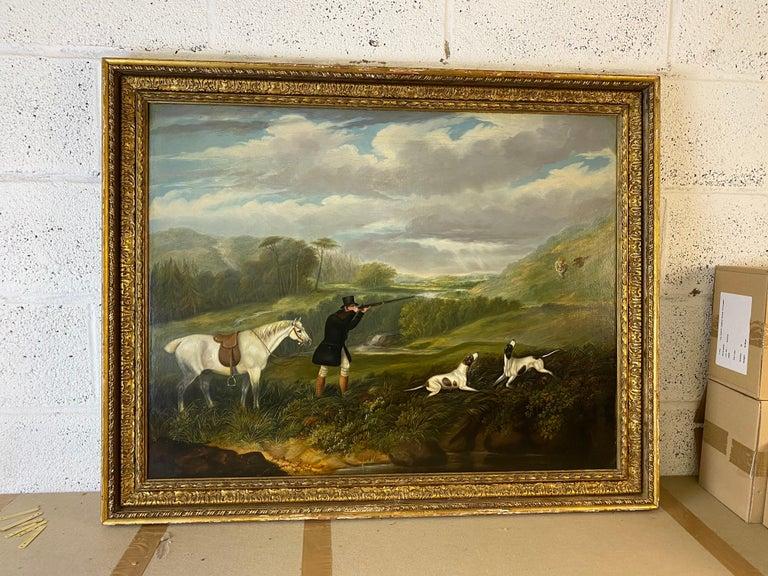 A gentleman partridge shooting in a landscape with dogs - Victorian Painting by Samuel John Egbert Jones