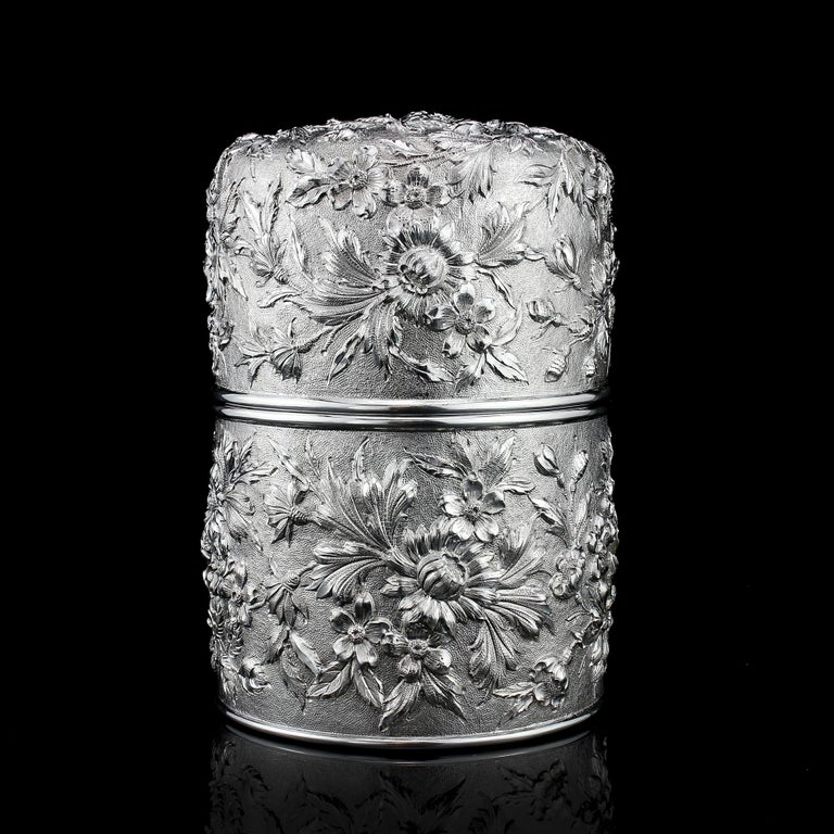 Antique 19th century American sterling silver tea caddy/cookie jar with repoussé metalwork of floral decorations in high relief.  Made in USA, 19th century. Made by Samuel Kirk & Son Fully Hallmarked  Samuel Kirk (February 15, 1793 - July 6,