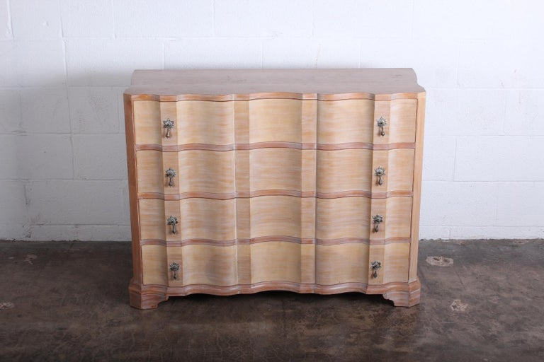 A beautiful four drawer dresser with cerused finished and brass hardware. Designed by Samuel Marx for Quigley.