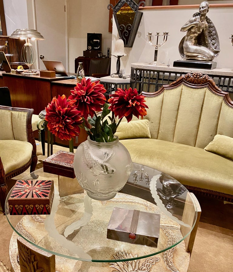 Sandblasted glass top Art Deco coffee table with silvered wood base. Stunning 3-D table design with floral impressions of leaves and flowers. Deep etched thick glass top, sits firmly on this wonderful silver-leafed table. Nice size round coffee