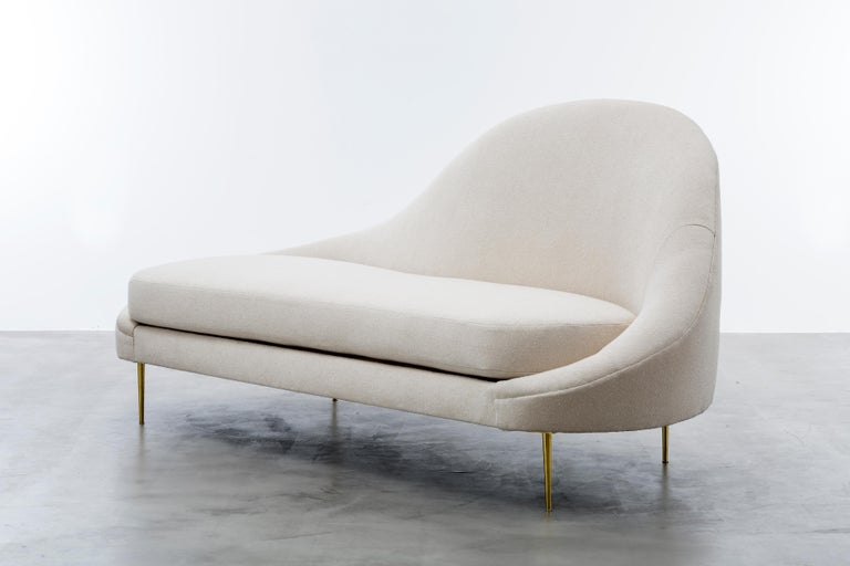 The Sandrine chaise inspired by the curvature of Gaudi architecture features an asymmetrical sophisticated velvet slope that meet solid brass legs to make a minimal and elegant statement. Fully custom and made to order in California. As shown in