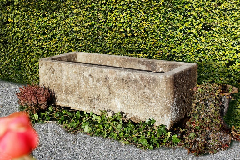 This is a well made sandstone fountain. The fountain is in a very good condition and can also be used as a wall fountain.