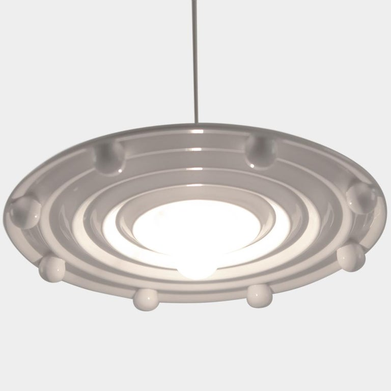 Here you are shown the Santa Ana Ceramic Ceiling Lamp with EU wiring accessibility, designed in 1983 by Matteo Thun. The Lamp is numbered and does not include the bulb.  Born 1952 in Bolzano, Italy. Matteo Thun studies under Oskar Kokoschka at the