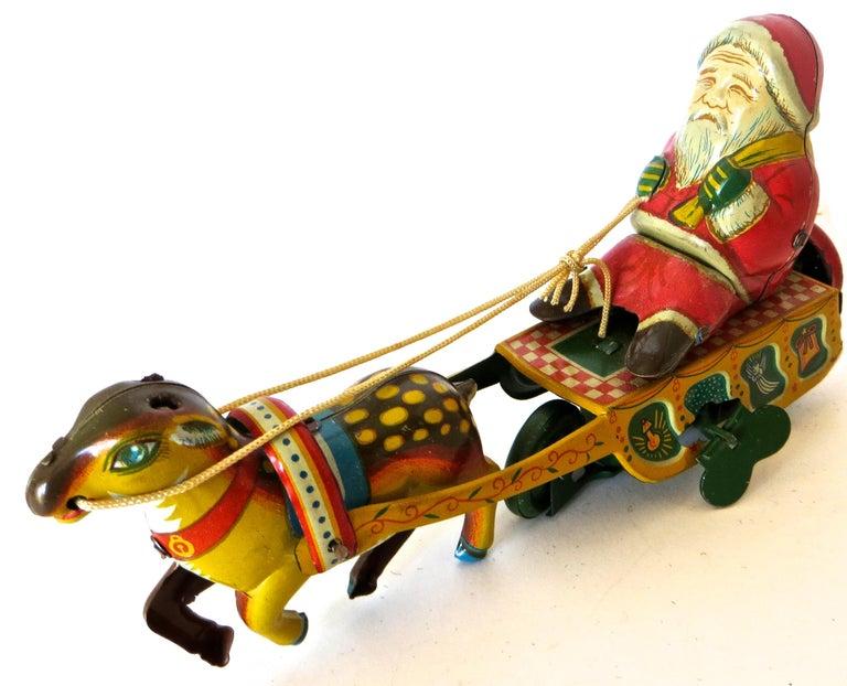 Folk Art Santa Claus in a Sleigh Wind Up Toy Japan, circa 1953 For Sale
