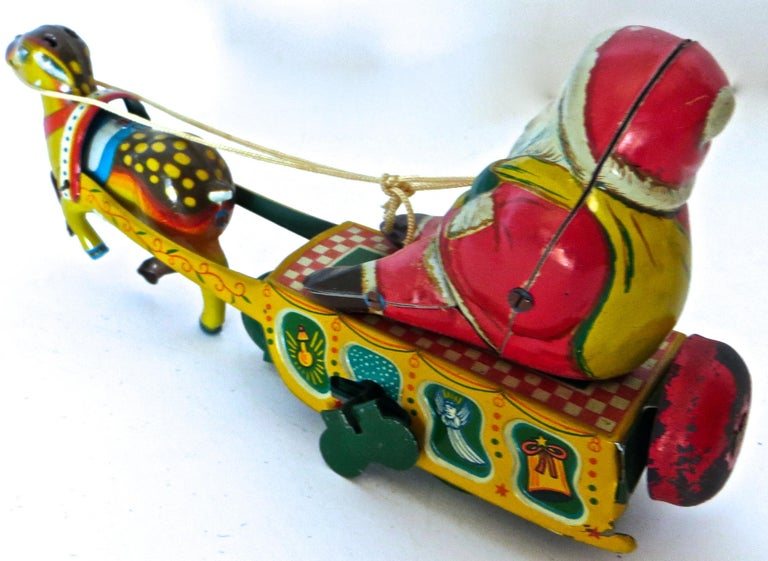 Japanese Santa Claus in a Sleigh Wind Up Toy Japan, circa 1953 For Sale