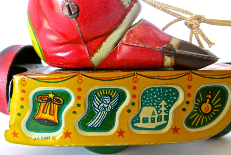 Tin Santa Claus in a Sleigh Wind Up Toy Japan, circa 1953 For Sale