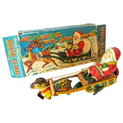 Santa Claus in a Sleigh Wind Up Toy Japan, circa 1953