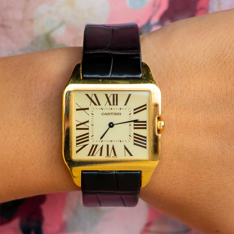 "Brand: Cartier  Movement: Mechanical Movement With Automatic Winding  18K Yellow Gold Case Diameter: 35.1 mm  Alligator-Skin Strap With The ""QuickSwitch"" Interchangeability System, Folding Buckle In 18K Yellow Gold  Water-Resistant Up To 30"