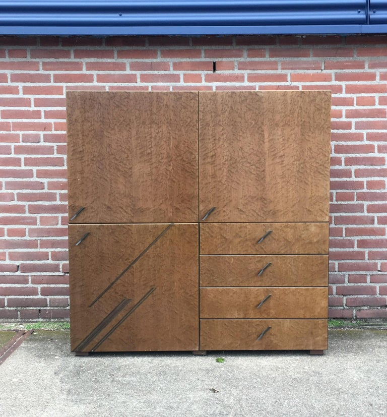 Wonderful Saporiti Higboard, manufactured in Italy. It consists of two pieces, a drawer piece and an upstanding piece with two doors. Both pieces have a shelve Inside. This cabinet remains in good condition but shows overall wear like some scratches