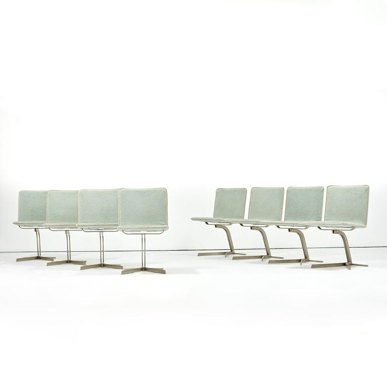 Eight dining chairs with original Saporiti labels to underneath  Made in Italy, circa 1970s  Anodized brushed steel angular frame, upholstery  Measures: 32 H x 19 D x 22 W in (seat height 18 in).