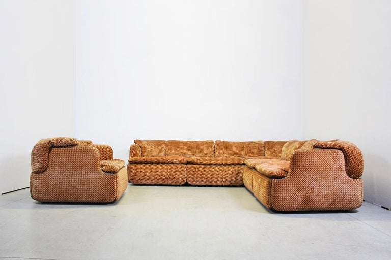 This sofa is from manufacture Saporiti Italia and has a red orange fabric. The sofa consist of 2 modules and also 1 armchair is included. Good condition  Dimensions: Sofa Width 240 cm Depth 240 cm    Armchair: Width 93 cm. Depth 85