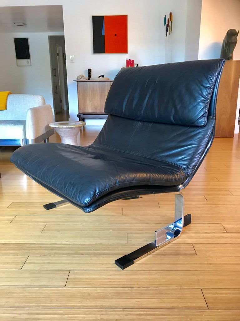 A handsome modernist design. Quality made of leather with architectural chrome plated steel base, rubber tips. Original vintage condition, minor ware, no damage.