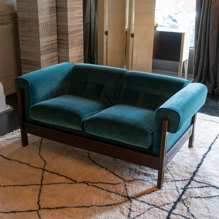 Pair of Saporiti sofas, rosewood frame in perfect vintage condition and patina and newly reupholstered cushions in cotton and viscose teal green velvet, Italy, circa 1960.
