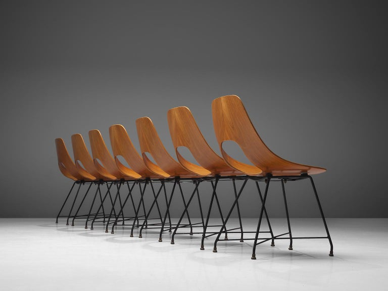 Augusto Bozzi for Saporiti, set of 7 'Ariston' dining chairs, teak, steel and brass, Italy, 1957.  Elegant set of seven 'Ariston' chairs designed by Augusto Bozzi for Saporiti. This set is made out of a solid bend plywood piece of teak have a very