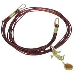 Sapphire 18 Karat Gold Figure Pendant on Multi-Strand Leather Choker Necklace