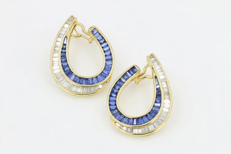 54 8ct sapphire dangle earrings 18 kt gold sapphire and baguette earrings in 18 karat yellow